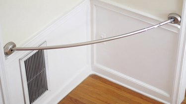 Tension rod hanging in corner of room
