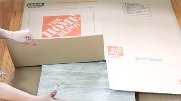inserting scrap board inside flattened box