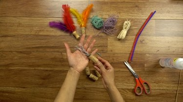 Tassel toy made from hemp twine and wine cork.