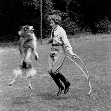 Vintage photo of a woman jumping rope with a dog