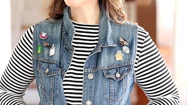 Woman wearing denim vest with kitty flair pins