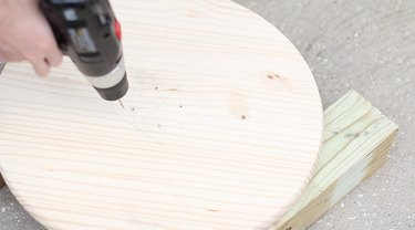 drilling pilot holes into wood circle