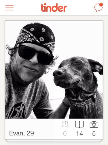 Man poses with dog for selfie in Tinder picture