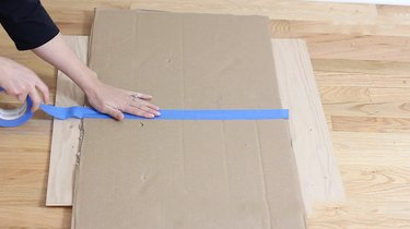 taping two box walls together to form roof