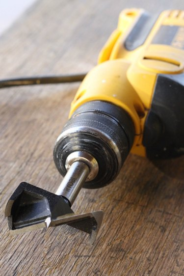 Drill with hole cutting bit