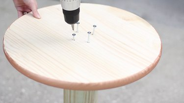 drilling screws into wood circle and post