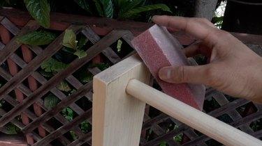 Sanding DIY dog puzzle feeder.