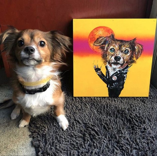 dog sitting next to his custom portrait