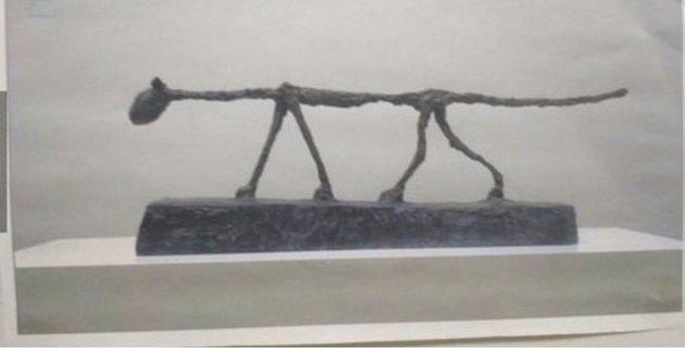 weird sculpture of skinny cat