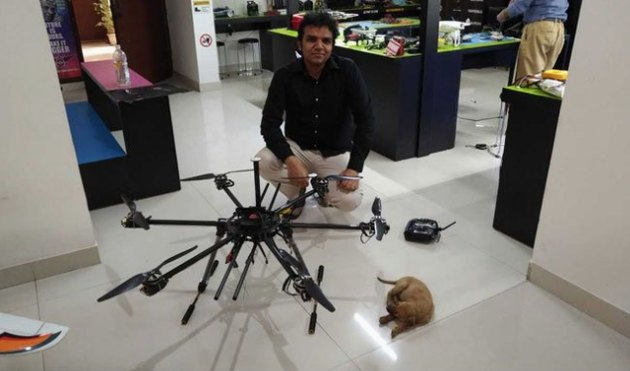 Man rescues puppy in storm drain with drone and robotic arm