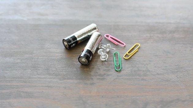 Batteries, paper clips and thumb tacks