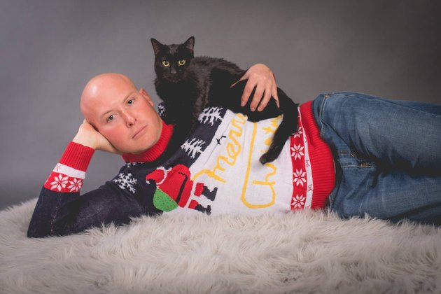 Christmas card photo of a guy and his cat