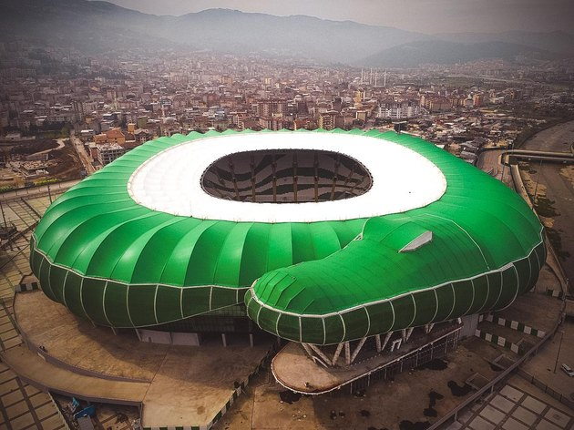 stadium shaped like a crocodile but also resembles coiled snek