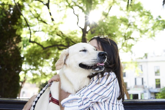 Young woman hugging her dog