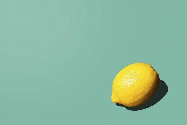 Lemon on teal background