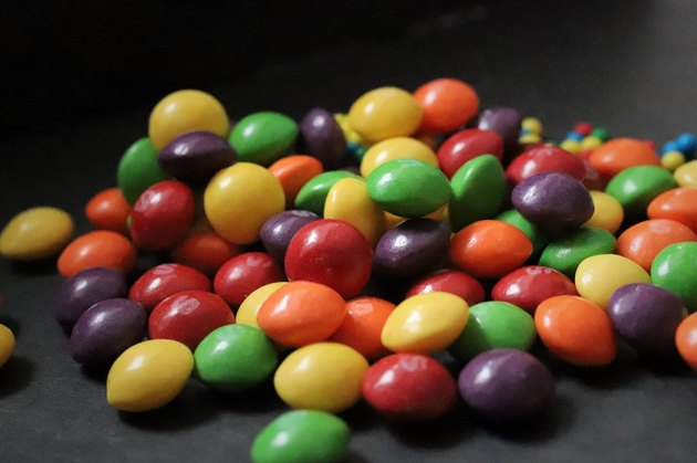 colorful small candies on black background