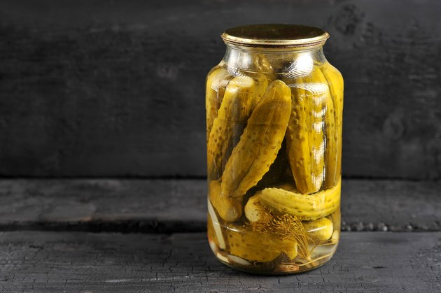 pickled homemade cucumbers in a glass jar