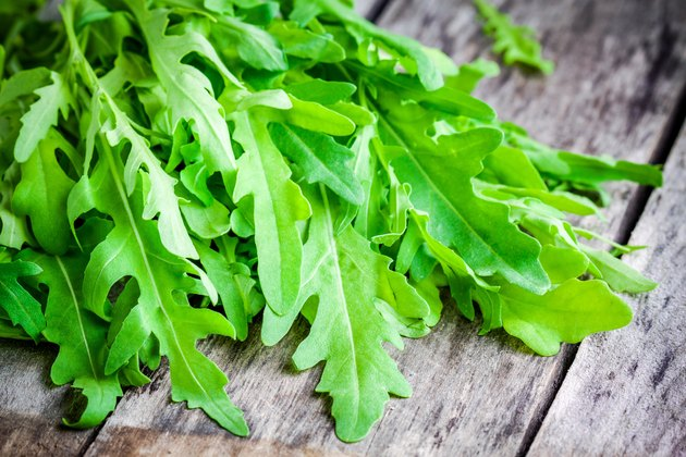 bunch of fresh organic arugula closeup