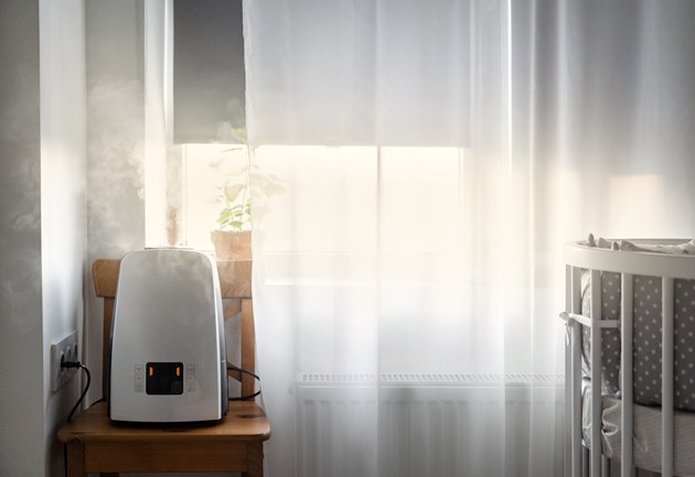 air purifier in room next to window