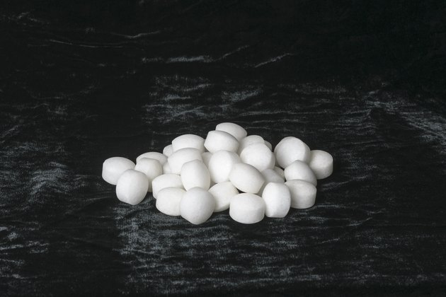 White naphthalene mothballs on black velvet