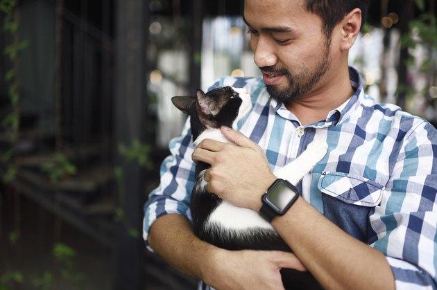 Portrait of a Malay man cuddling his cat
