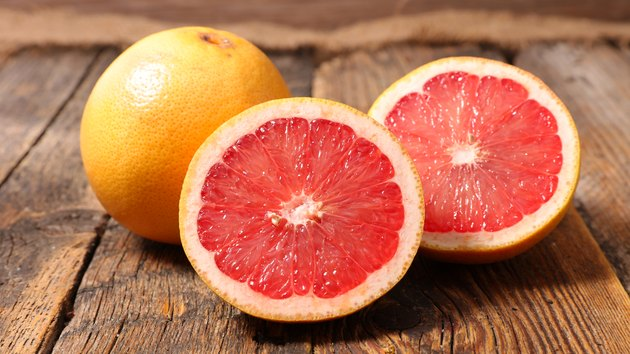 grapefruit on wood background