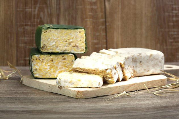 slices  of raw Tempeh on cutting board