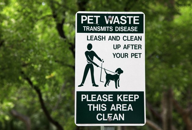 Pet waste sign at the park in Miami