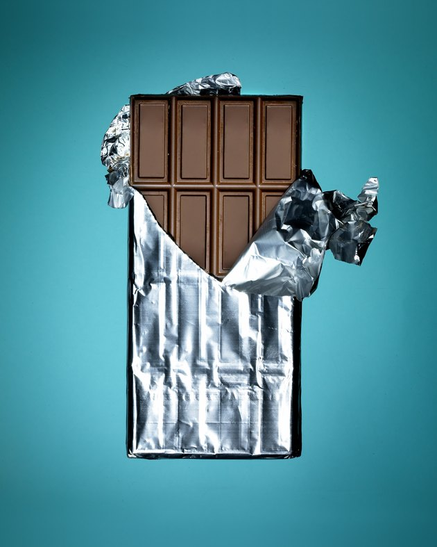 Close-up of whole chocolate bar on turquoise background