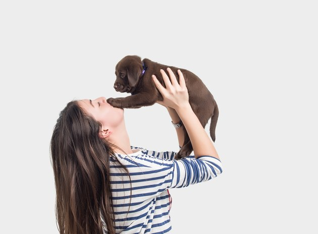 Side view of woman playing with her dog