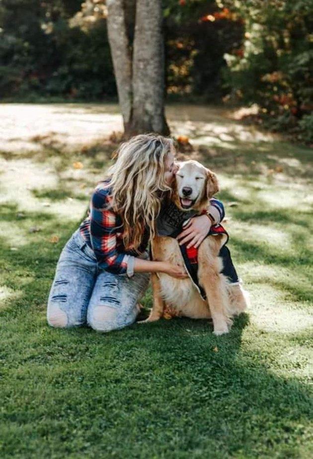 woman hugs smiling dog