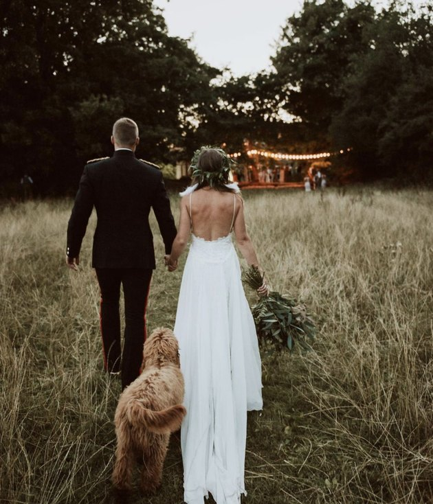 dog trailing bride and groom