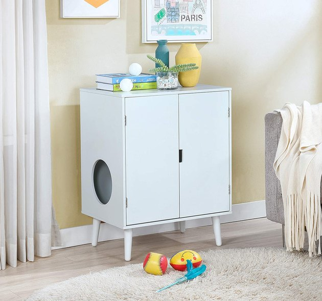 HIDDEN IN PLAIN SIGHT: The Contemporary Cat Litter Hide-Away Cabinet features a sleek and modern design that blends seamlessly with existing home décor. There is a circular opening on the side, allowing your cat to jump in and out as they please, while keeping the front doors closed. Your cat will greatly appreciate the privacy.