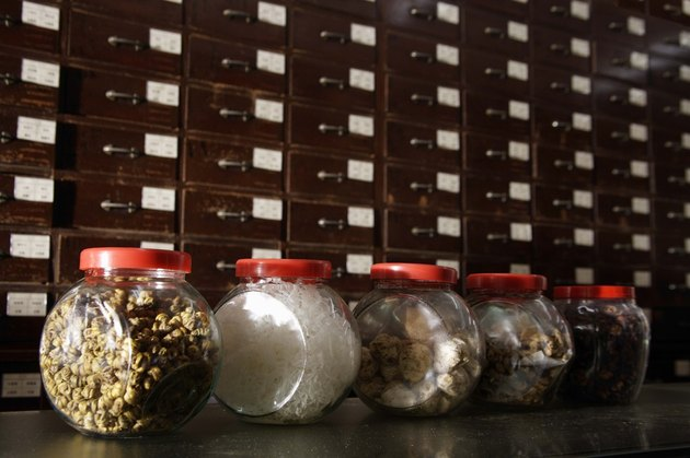Row of Chinese medicinal herbs in jars