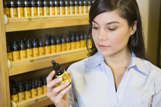 Woman reading label of organic product