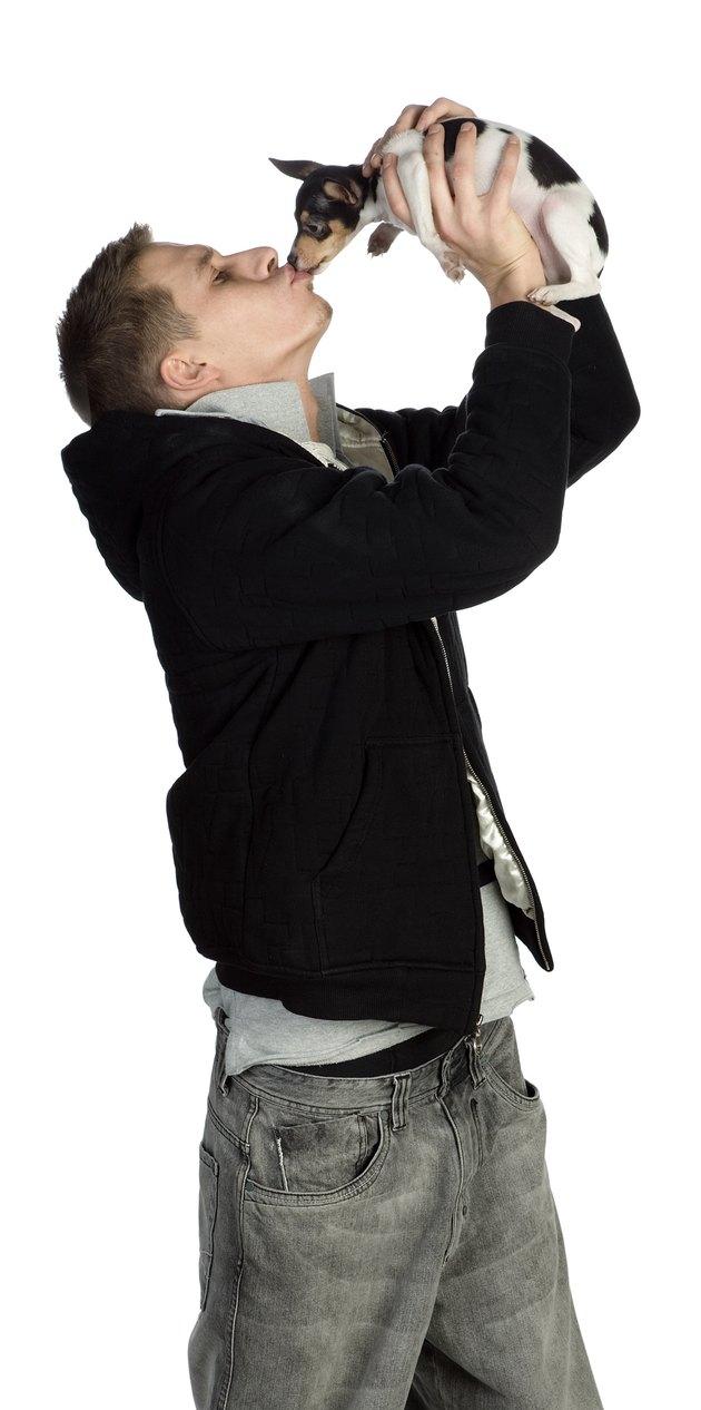 Man kissing pet dog