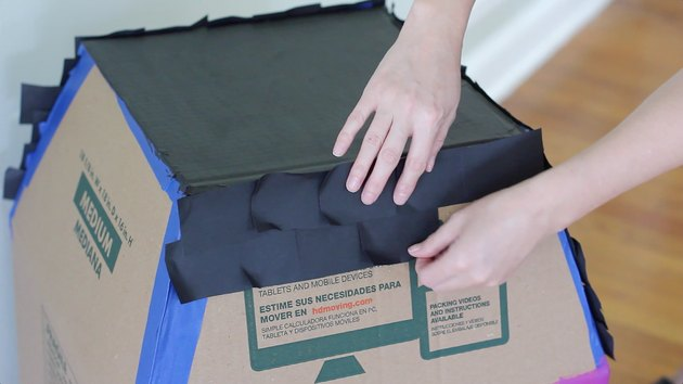 Taping paper roof shingles to roof