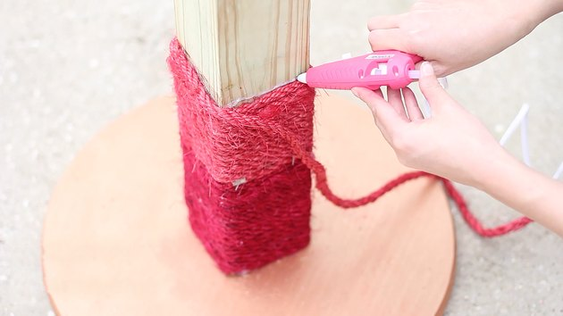 gluing yarn around the post