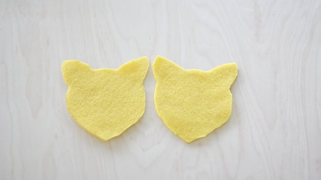 Two felt head shapes