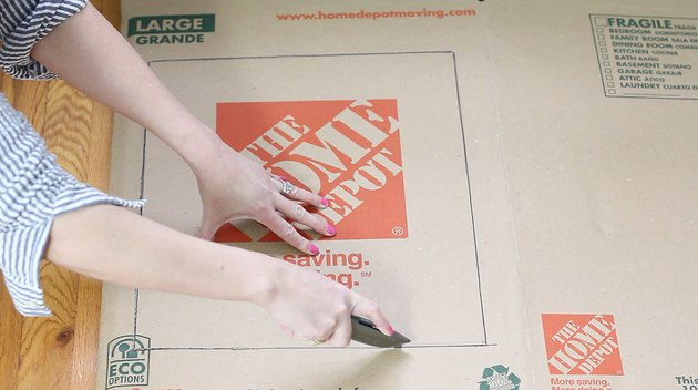 cutting out square with box cutter