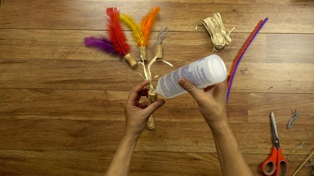 Gluing twine for DIY cat toys out of wine corks.