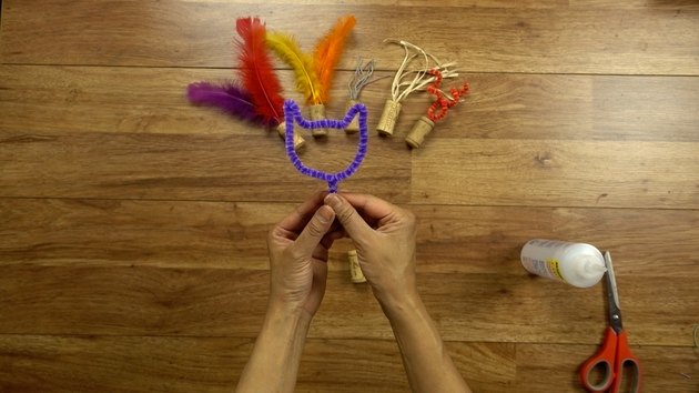 DIY cat toys out of a wine cork and pipe cleaner.