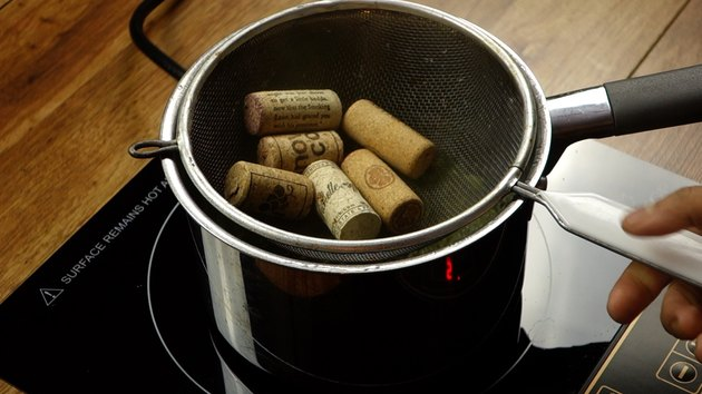 Steaming wine corks for DIY cat toys out of wine corks.