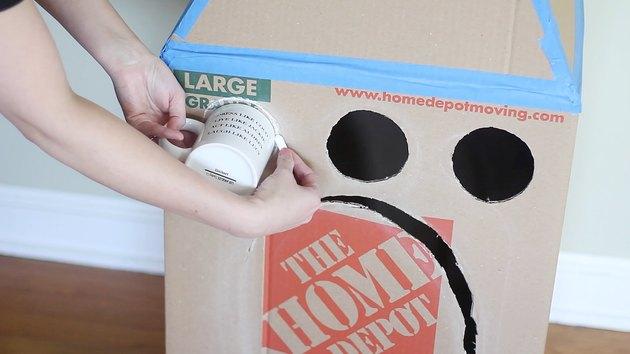 Tracing mug on front of box