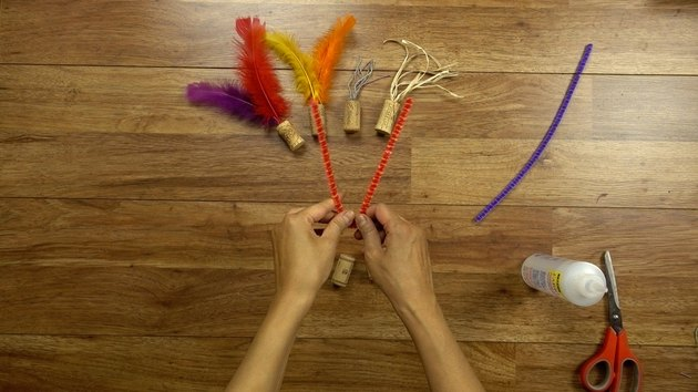 Bending pipe cleaner for DIY cat toys out of wine corks
