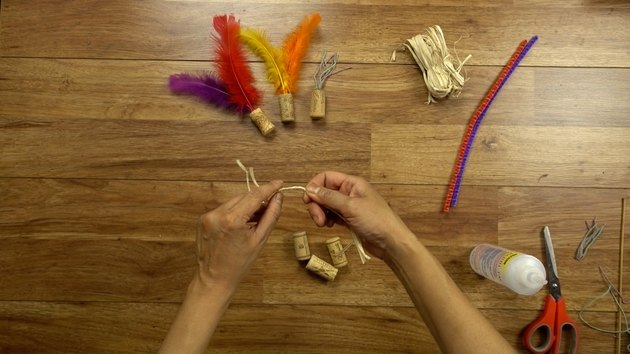 Preparing raffia for DIY cat toys out of wine corks.