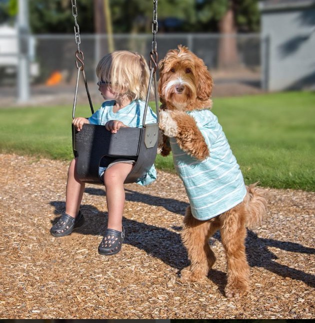 Pushing Little Buddy on the swing