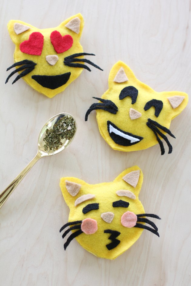 Three emoji catnip toys