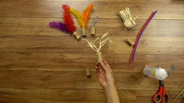 Tassel toy made from raffia and wine cork.