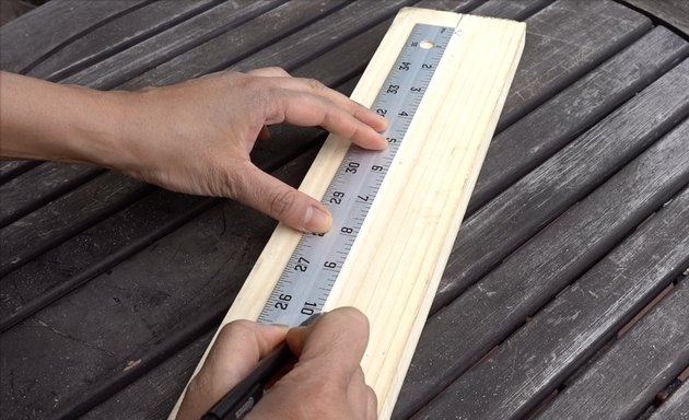 Marking planks for DIY dog puzzle feeder.